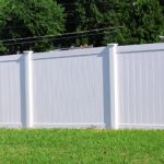 Vinyl Fence and green grass